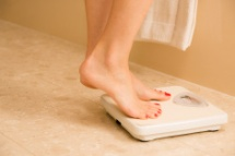 stock-photo-64529833-healthy-lifestyle-weight-conscious-woman-standing-on-bathroom-scale-dieting